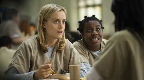 Taylor Schilling and Uzo Aduba in a scene from the TV series Orange is the New Black.