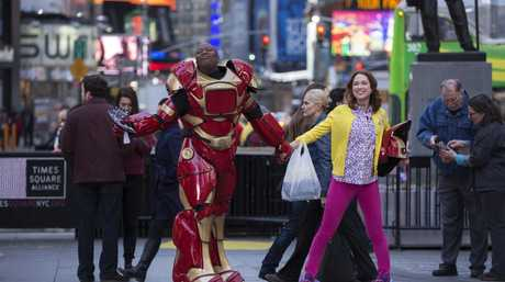 Tituss Burgess and Ellie Kemper in a scene from Unbreakable Kimmy Schmidt.