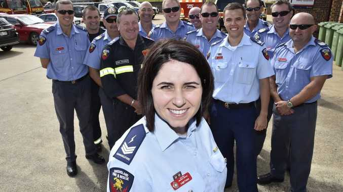 Toowoomba fire communications officer Leigh Frame is congratulated by colleagues and firefighters for receiving a Commissioner's Unit Citation.