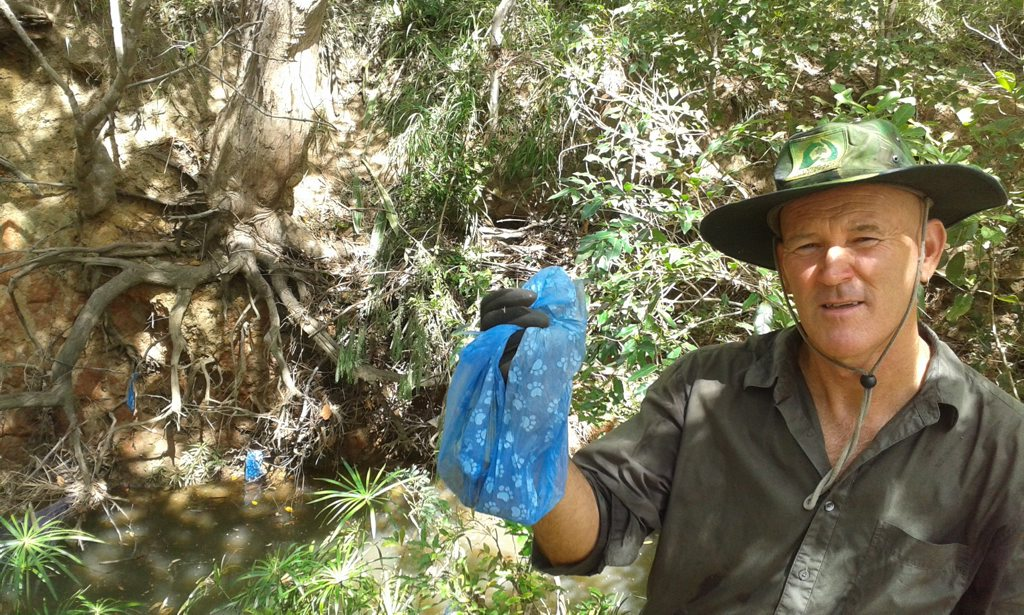 Mike Johnson of Bundaberg Landcare with rubbish found dumped at Saltwater Creek. Photo Contributed