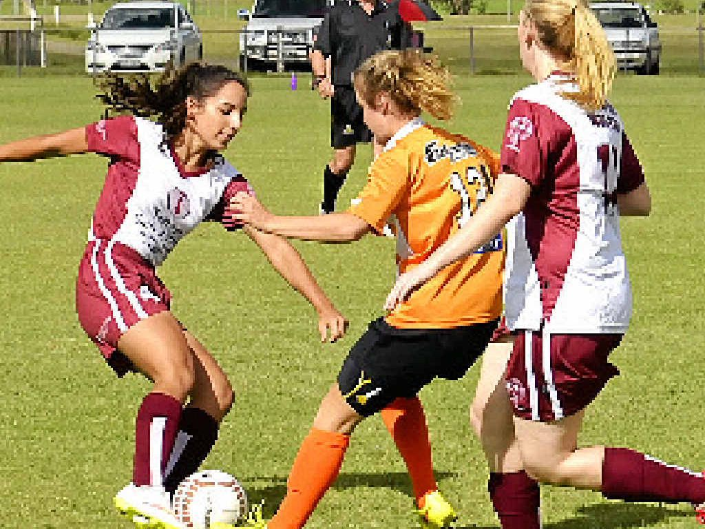 Maddy Ross (Warwick), Tara Swenney (City) and Laura Wyvill (Warwick) in women's football action at Queens Park.