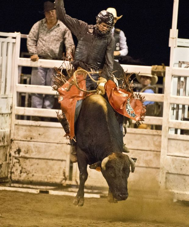 Image for sale: Justin Paton on Unstoppable. PBR Bullride at Dalby Showgrounds. Saturday, Mar 21 , 2015 . Photo Nev Madsen / The Chronicle