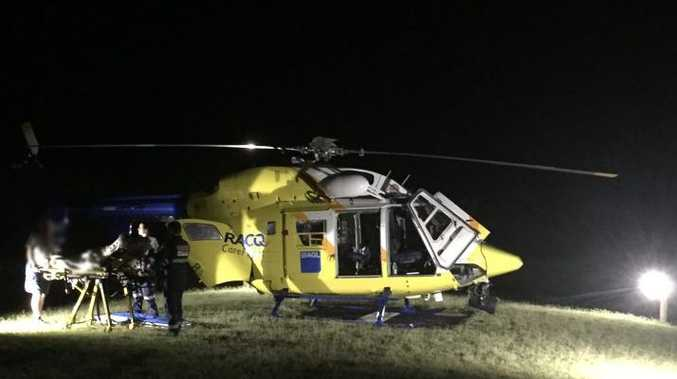 An RACQ CareFlight Rescue team flew to the aid of a backpacker on Fraser Island in the early hours of Tuesday after she was suspected to have been bitten by a snake.