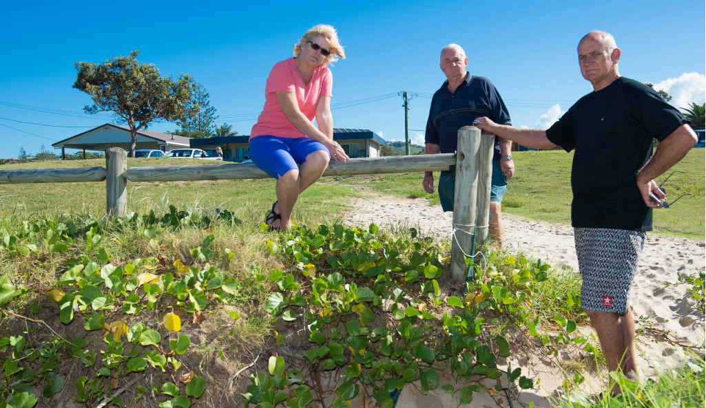 RISING CONCERNS: Woolgoolga residents Debbie Wookey, Trevor Goldthorpe and Ian Vary have concerns about Coffs Harbour City Council's rising sea level predictions.