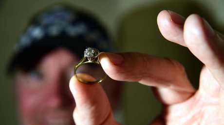 RECOGNISE IT? Sergeant Darren Taylor of Nambour Police holds a diamond ring they received in strange circumstances – it was posted in with a note, anonymously, and police are hoping to find its original owner.
