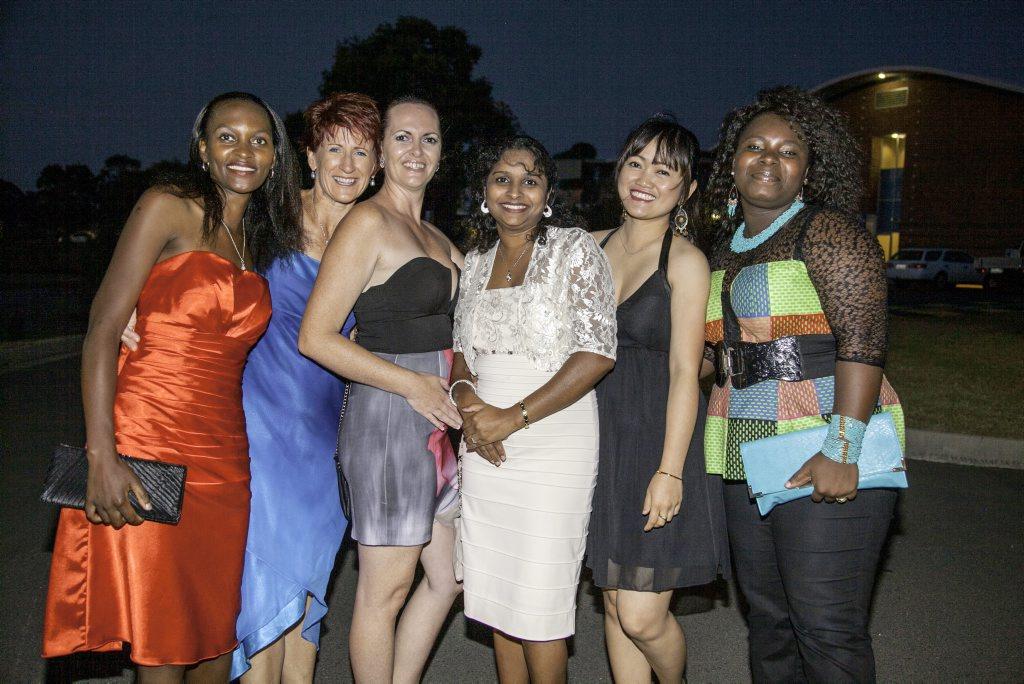 Devika Gaundar (centre in white) joins local and other international students Mercy Tsenesa, Dee Woodgate, Michelle Denny, Jennifer Gavino and Ibiye George at the USQ Fraser Coast gala evening in November last year.