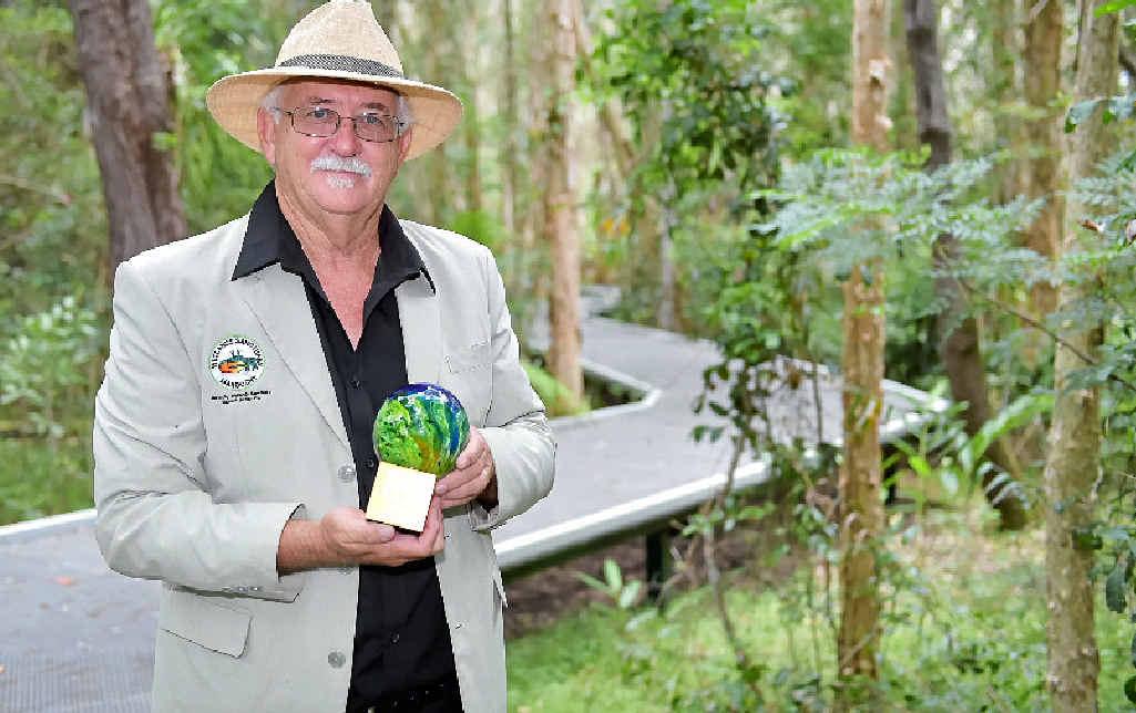 ENVIRONMENTALIST: Derek Foster with his Australia Day award.