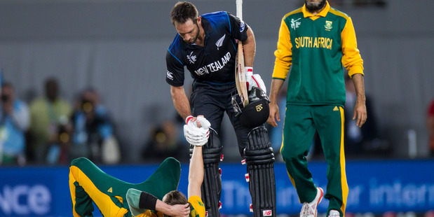 Grant Elliott helps up a upset Dale Steyn of South Africa after the end of the ICC Cricket World Cup semi-final match between New Zealand and South Africa at Eden Park, Auckland. 24 March 2015