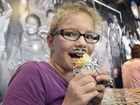 LOVE THEM: Grace Bogdan loves the Burritos being given away at Guzmon, on Ruthven Street Photo Bev Lacey / The Chronicle