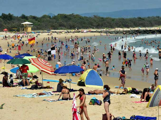 MUST VISIT: Holiday crowds flock to Noosa Main Beach which has been ranked in the top 10 places to visit in Australia.