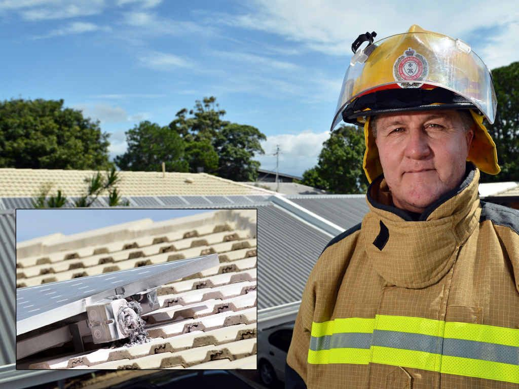 MELTDOWN: Caloundra Fire Station officer Conrad Ware inspects a potential fire hazard caused by a solar panel isolator on a Caloundra home yesterday.