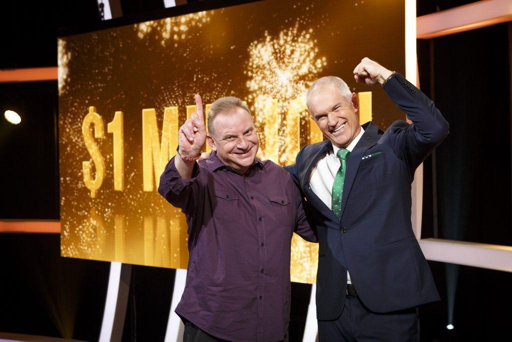 Million Dollar Minute winner Andrew Skarbek pictured with host Simon Reeve.