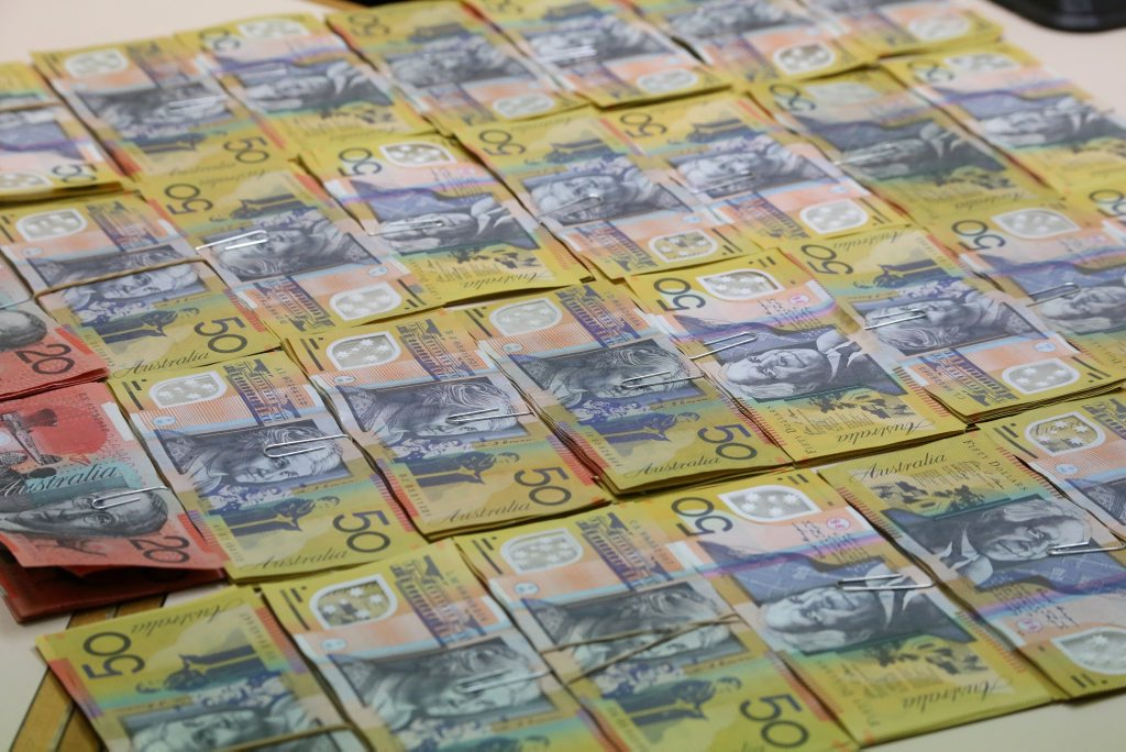 CASHED UP: More than $17,000 was found when police raided a house in Murray Pde.