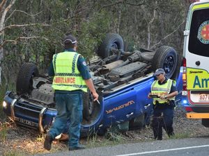 Driver trapped after four-wheel drive rollover on Booral Rd