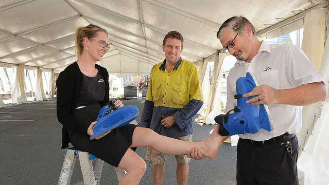 Holly Bolto of Caneland Central tried out some ice skates assisted by Herbert Colls (right) of Caneland Central and ice skating manager Jason Buchholz. The ice skating rink will run from April 1-19.
