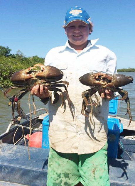 GETTING SNIPPY: Jake Robbo with a fine pair of coory crabs.