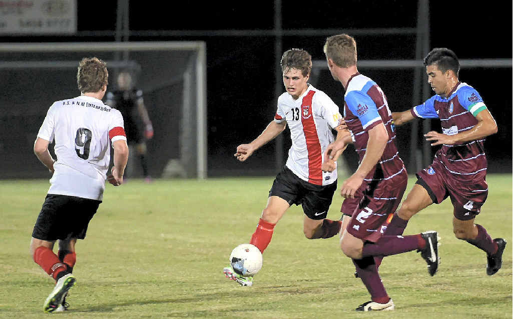 SPRING IN THEIR STEP: Caboolture's Jack Hayes takes on the Gympie defence during a FFA Cup tussle at Maroochydore.