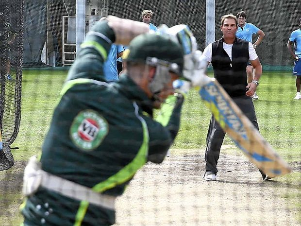 MASTER CLASS: Michael Clarke plays a shot in the nets to the bowling of Shane Warne.