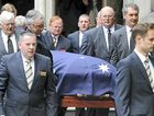 Malcolm Fraser's coffin is carried from the church yesterday. At top right his wife Tamie is consoled and below a group of Vietnamese migrants pays tribute.