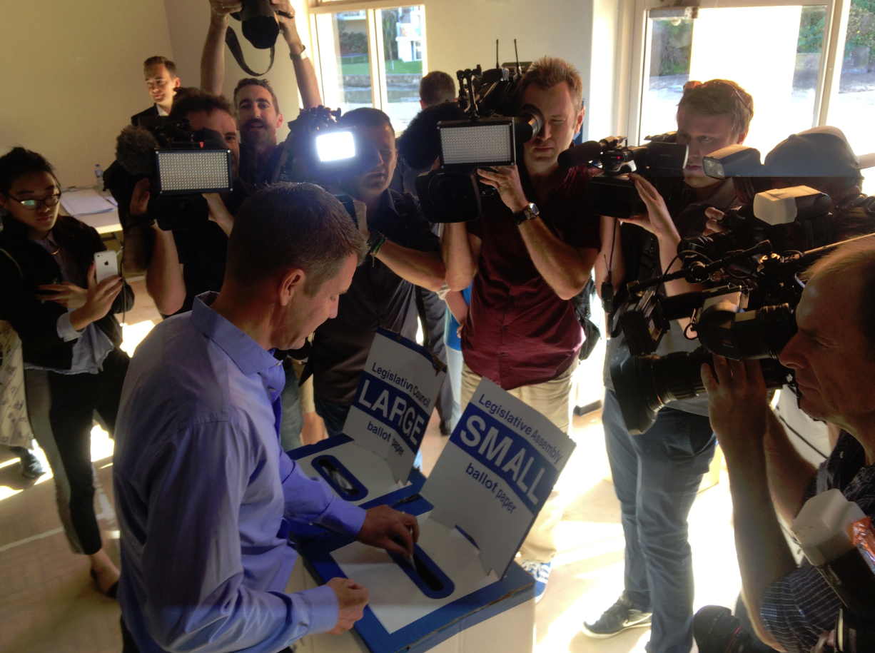 Premier Mike Baird casts his vote at the Queenscliff Surf Lifesaving Club on Saturday.
