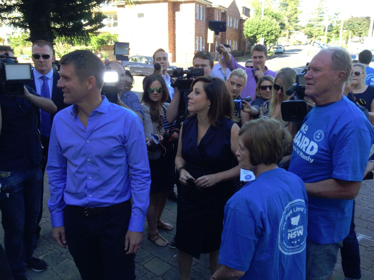 Premier Mike Baird makes his way to the Queenscliff Surf Lifesaving Club polling booth with wife Kerryn, father Bruce and mother Judy for support.