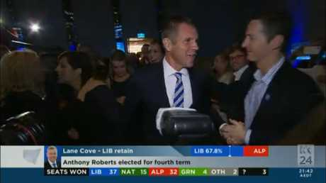 NSW Premier Mike Baird arrives to make his victory speech.