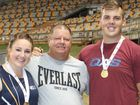 Toowoomba's 2015 national open hammer throw champions Lara Nielsen and Matthew Denny with coach Grahame Pitt following their victories on Friday at the Australian Athletics Championships in Brisbane.