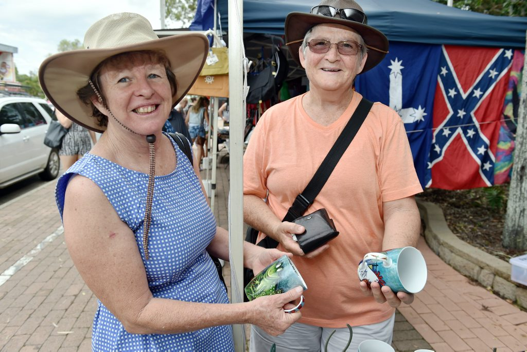 Image for sale: Torquay Esplanade markets - Quirky - Jan Schwerin and Heather Pitt found some hand painted mugs. Photo: Valerie Horton / Fraser Coast Chronicle