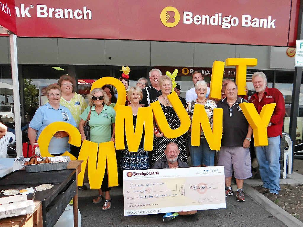 HAPPY BIRTHDAY: Guests at the Calliope Community Bendigo Bank sixth birthday party were the ones receiving presents with community organisations presented with cheques.
