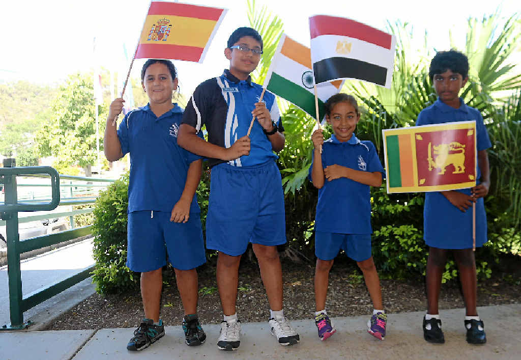 Gladstone West State School students Clarita Pereze of Spain, Margil Rajaji of India, Mariam Taha of Egypt and Jaya Sivananthan of Sri Lanka. Photo Laura McKee