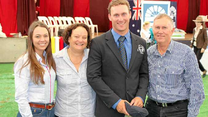 GOOD CALL: Rockhampton selling agent Josh Heck with girlfriend Megan Gurnett and parents Yvonne and Brian Heck at Sydney's Royal Easter Show where Josh competed in the National Young Auctioneers competition.