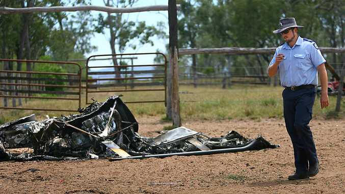 CRASH SCENE: Senior Constable John Shilton assesses the site where a helicopter crashed at Tartrus Station in 2007.