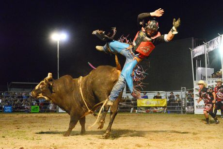 Dave Kennedy riding Astro Boy at the PBR Bullriding Rural Weekly Live Series held at the Grafton Showgrounds. Photo:Bruce Thomas / Daily Examiner March 28, 2015