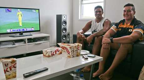 Micaiah Chapman and Josh Noovao went to Gladstone State High together and play each other in rugby union.  They settled in to watch the cricket world cup final on Sunday.