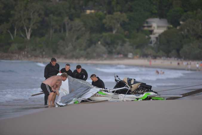 Police retrieve the ultrslight that crashed off Noosa Main beach. Photo: John McCutcheon / Sunshine Coast Daily