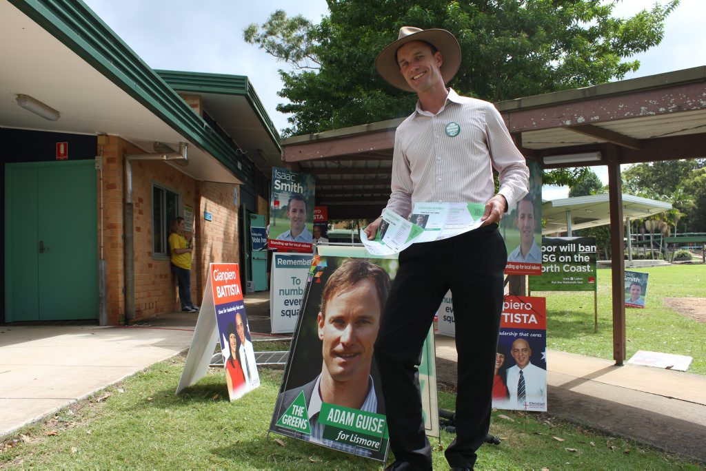 Adam Guise handing out How To Votes at Goonellabah Public School on election day.