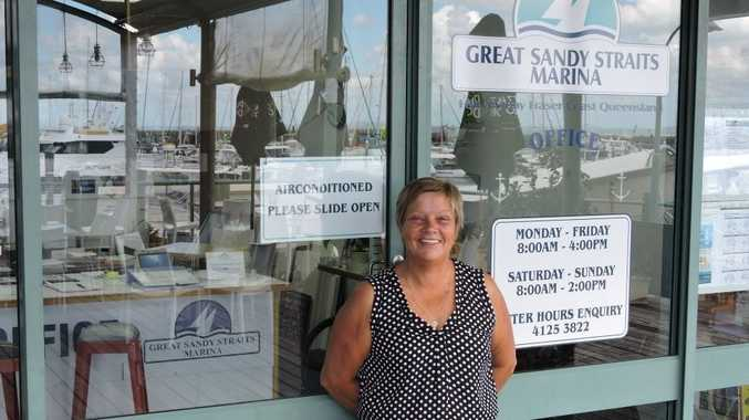 Manager of Great Sandy Straits Marina Debbie Rafter proudly stands out the front of her new office.