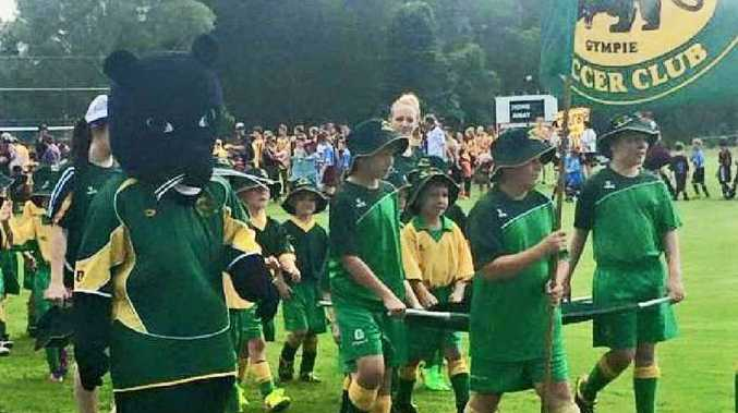 TEAM SPIRIT: Gold City won the new Ron Dyne trophy for the best display of team spirit in the march past which launched the Football Gympie 2015 season on the weekend.