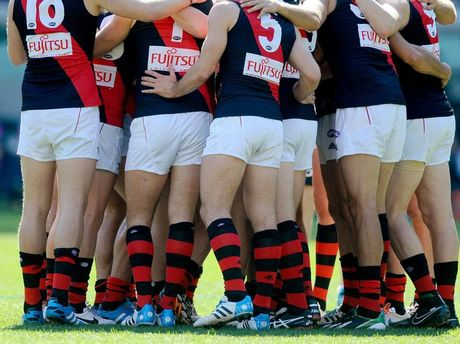 Essendon players get into a huddle before the start of the Round 23 AFL match between the Carlton Blues and Essendon Bombers at the MCG in Melbourne.