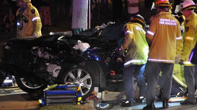Emergency services work to cut a man out of his car after it crashed on Chapman Dr, Gladstone in March.