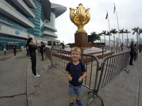 Scott McIllwain-Pershouse, 7, takes in the sights of Hong Kong, during a holiday which included celebrating his mum Amanda Pershouse's birthday.