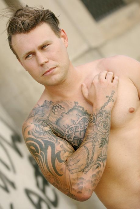 Bryan Perry shows his religious and life & death inspired ink. Photo: Tamara MacKenzie / The Morning Bulletin
