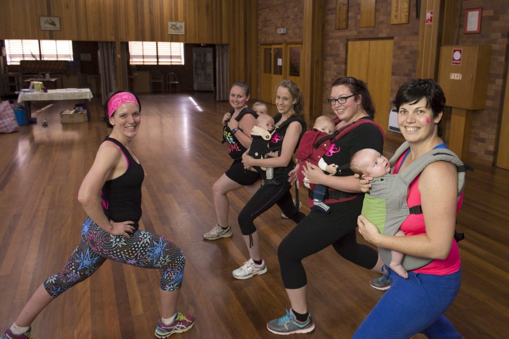 Kangatraining Toowoomba instructor Natalie Fraser (left) shows mums and bubs (from left) Codie McKeon with Declan, Alicia Campbell with Hunter, Jacynta Clayton with Tobias and Jen Stark with her six-week-old Alex at the first birthday celebration dance party.
