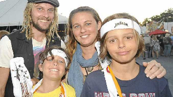 Andy Manning, Finn Caban (8), Vanessa Andrews and Will Caban (11), all of Murwillumbah, enjoy the sights and sounds of last year's Byron Bay Bluesfest.