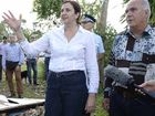 Queensland Premier Annastacia Palaszczuk and Livingstone Shire Mayor Bill Ludwig survey Tropical Cyclone Marcia's damage to a house in Braithwaite St, Yeppoon. AAP