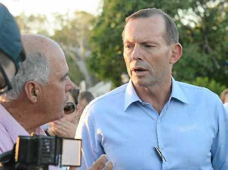 Cr Bill Ludwig talking to PM Tony Abbott in Yeppoon. Allan Reinikka