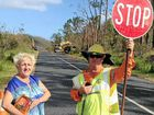 PULLING TOGETHER: Capricornia MP Michelle Landry hands out cold drinks to road workers near Byfield. Contributed