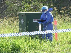 Police search surrounding area of alleged murder scene