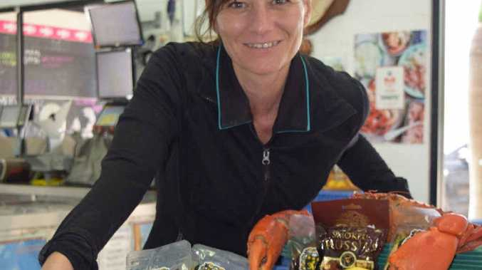 EASTER FEAST: Retail manager Joanna Duncan with some of the tasty seafood treats at Rosslyn Bay Fishermans Market on the Capricorn Coast.