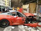 A Ferrari GTO 599 is destroyed after a valet apparently pressed the wrong pedal, smashing it into a shop